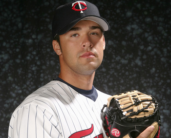 FORT MYERS, FL - FEBRUARY 27: Garrett Jones #50 of the Twins poses for a portrait during the Minnesota Twins Photo Day at the Lee County Sports complex on February 27, 2006 in Fort Myers, Florida. (Photo by Nick Laham/Getty Images)
