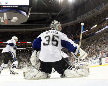PITTSBURGH, PA - APRIL 27:  Dwayne Roloson #35 of the Tampa Bay Lightning protects the net against the Pittsburgh Penguins in Game Seven of the Eastern Conference Quarterfinals during the 2011 NHL Stanley Cup Playoffs at Consol Energy Center on April 27,