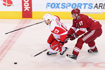 GLENDALE, AZ - APRIL 20:  Pavel Datsyuk #13 of the Detroit Red Wings skates with the puck past Radim Vrbata #17 of the Phoenix Coyotes in Game Four of the Western Conference Quarterfinals during the 2011 NHL Stanley Cup Playoffs at Jobing.com Arena on Apr