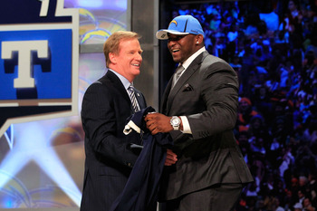 NEW YORK, NY - APRIL 28:  NFL Commissioner Roger Goodell (L) greets Corey Liuget, #18 overall pick by the San Diego Chargers, on stage during the 2011 NFL Draft at Radio City Music Hall on April 28, 2011 in New York City.  (Photo by Chris Trotman/Getty Im