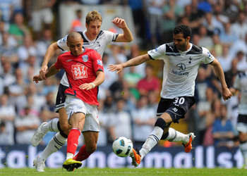 LONDON, ENGLAND - APRIL 23: Raniere Sandro and Michael Dawson of Spurs close down Peter Odemwingie of West Brom during the Barclays Premier League match between Tottenham Hotspur and West Bromwich Albion at White Hart Lane on April 23, 2011 in London, Eng