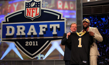 NEW YORK, NY - APRIL 28:  NFL Commissioner Roger Goodell (L) poses for a photo with Cameron Jordan, #24 overall pick by the New Orleans Saints, holds up a jersey on stage during the 2011 NFL Draft at Radio City Music Hall on April 28, 2011 in New York Cit