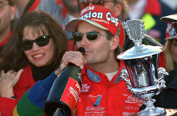 ATLANTA - NOVEMBER 12:  Jeff Gordon of DuPont Chevrolet celebrates in victory lane drinking champagne after winning the Winston Cup championship in the NASCAR NAPA 500 at the Atlantic Motor Speedway on November 12, 1995 in Atlanta, Georgia.  (Photo by Dav