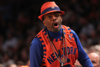 NEW YORK, NY - APRIL 22:  Director Spike Lee reacts as the New York Knicks play against the Boston Celtics in Game Three of the Eastern Conference Quarterfinals in the 2011 NBA Playoffs on April 22, 2011 at Madison Square Garden in New York City. The Celt