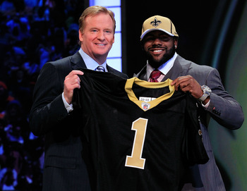 NEW YORK, NY - APRIL 28:  NFL Commissioner Roger Goodell (L) poses for a photo with Mark Ingram, #28 overall pick by the New Orleans Saints, holds up a jersey on stage during the 2011 NFL Draft at Radio City Music Hall on April 28, 2011 in New York City.