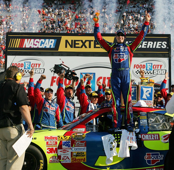 BRISTOL, TN - MARCH 25:  Kyle Busch, driver of the #5 Carquest/Kellogg's Chevrolet, celebrates in victory lane after winning the NASCAR Nextel Cup Series Food City 500 at Bristol Motor Speedway on March 25, 2007 in Bristol, Tennessee. Busch became the fir