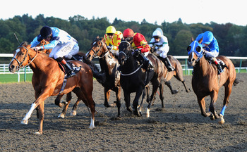LINGFIELD, ENGLAND - OCTOBER 13:  Richard Hughes on Hierarch (left) on thier way to victory in the L & M Body Repairs Legendary Classified Claiming Stakes (div 2) race at Lingfield Park on October 13, 2010 in Lingfield, England.  (Photo by Mike Hewitt/Get