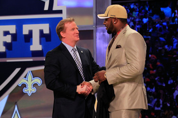 NEW YORK, NY - APRIL 28:  NFL Commissioner Roger Goodell (L) greets Cameron Jordan, #24 overall pick by the New Orleans Saints, on stage during the 2011 NFL Draft at Radio City Music Hall on April 28, 2011 in New York City.  (Photo by Cameron Jordan/Getty