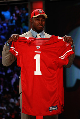 NEW YORK, NY - APRIL 28:  Aldon Smith, #7 overall pick by the San Francisco 49ers, holds up a jersey on stage during the 2011 NFL Draft at Radio City Music Hall on April 28, 2011 in New York City.  (Photo by Chris Trotman/Getty Images)