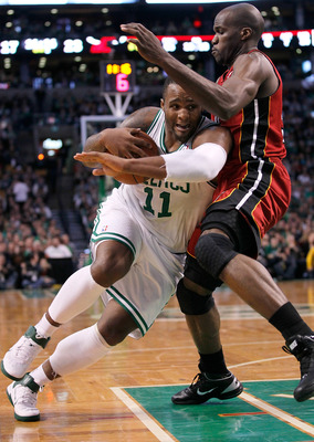BOSTON - FEBRUARY 13:  Glen Davis #11 of the Boston Celtics drives against Joel Anthony #50 of the Miami Heat at TD Garden on February 13, 2011 in Boston, Massachusetts. The Celtics won 85-82. NOTE TO USER: User expressly acknowledges and agrees that, by