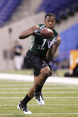 INDIANAPOLIS, IN - FEBRUARY 28: Akeem Ayers of UCLA works out during the 2011 NFL Scouting Combine at Lucas Oil Stadium on February 28, 2011 in Indianapolis, Indiana. (Photo by Joe Robbins/Getty Images)