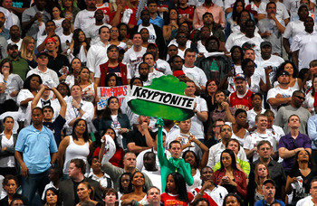 ATLANTA, GA - APRIL 28:  A fan hold up a neon green sign with the words 'Kryptonite' written on it during Game Six of the Eastern Conference Quarterfinals in the 2011 NBA Playoffs between the Atlanta Hawks and the Orlando Magic at Philips Arena on April 2