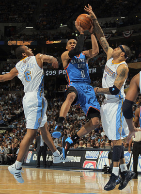 DENVER, CO - APRIL 23:  Russell Westbrook #0 of the Oklahoma City Thunder puts up a shot between Arron Afflalo #6 and Kenyon Martin #4 of the Denver Nuggets in Game Three of the Western Conference Quarterfinals in the 2011 NBA Playoffs on April 23, 2011 a