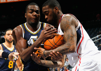 ATLANTA - NOVEMBER 12:  Josh Powell #12 of the Atlanta Hawks battles for a rebound against Paul Millsap #24 of the Utah Jazz at Philips Arena on November 12, 2010 in Atlanta, Georgia.  NOTE TO USER: User expressly acknowledges and agrees that, by download