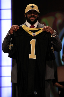 NEW YORK, NY - APRIL 28:  Mark Ingram, #28 overall pick by the New Orleans Saints, holds up a jersey on stage during the 2011 NFL Draft at Radio City Music Hall on April 28, 2011 in New York City.  (Photo by Chris Trotman/Getty Images)