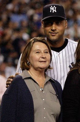 NEW YORK - SEPTEMBER 21: Derek Jeter #2 of the New York Yankees poses with his family, father Charles mother Dorothy and sister Sharlee,during pregame ceremonies prior to the start of the last regular season game at Yankee Stadium between the Baltimore Or
