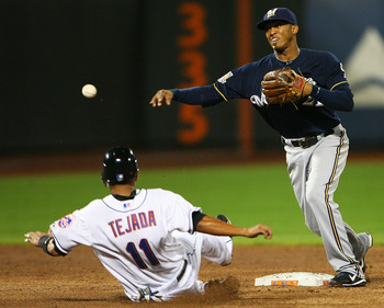 NEW YORK - SEPTEMBER 28:  Alcides Escobar #21 of the Milwaukee Brewers completes a double play while Ruben Tejada #11 of the New York Mets is unsuccessful sliding into second base on September 28, 2010 at Citi Field in the Flushing neighborhood of the Que