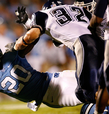 CHAPEL HILL, NC - OCTOBER 04:  Running back Shaun Draughn #20 of the North Carolina Tar Heels dives for more yardage against Scott Lutrus #32 of the Connecticut Huskies during the game at Kenan Stadium on October 4, 2008 in Chapel Hill, North Carolina.  (
