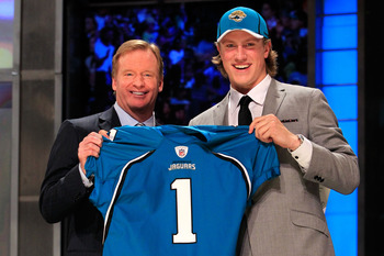NEW YORK, NY - APRIL 28:  NFL Commissoner Roger Goodell poses for a photo with Blaine Gabbert, #11 overall pick by the Jacksonville Jaguars, holds up a jersey during the 2011 NFL Draft at Radio City Music Hall on April 28, 2011 in New York City.  (Photo b