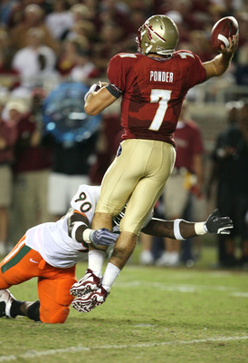 TALLAHASSEE, FL - SEPTEMBER 07:  Quarterback Christian Ponder #7 of the Florida State Seminoles throws a pass as he is hit by defensive lineman Steven Wesley #90 of the Miami Hurricanes at Doak Campbell Stadium on September 7, 2009 in Tallahassee, Florida