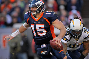 DENVER - JANUARY 02:  Quarterback Tim Tebow #15 of the Denver Broncos scrambles against the San Diego Chargers at INVESCO Field at Mile High on January 2, 2011 in Denver, Colorado.  (Photo by Doug Pensinger/Getty Images)