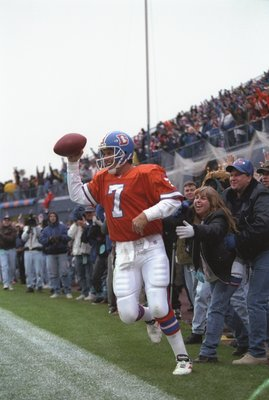 20 Oct 1996:  Quarterback John Elway of the Denver Broncos celebrates after scoring the winning touchdown during the Broncos 45-34 win over the Baltimore Ravens at Mile High Stadium in Denver, Colorado.  Mandatory Credit: Brian Bahr  /Allsport