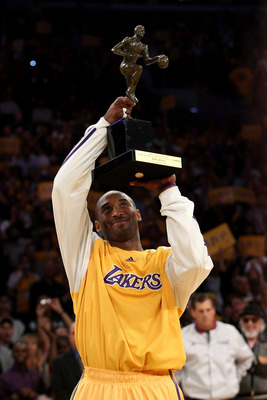 LOS ANGELES, CA - MAY 07:  Kobe Bryant #24 of the Los Angeles Lakers looks up at the MVP Trophy before the start of Game Two of the Western Conference Semifinals against the Utah Jazz during the 2008 NBA Playoffs on May 7, 2008 at Staples Center in Los An