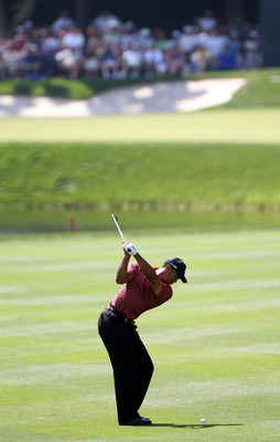 ORLANDO, FL - MARCH 27:  Tiger Woods plays a shot on the 8th hole during the final round of the Arnold Palmer Invitational presented by MasterCard at the Bay Hill Club and Lodge on March 27, 2011 in Orlando, Florida.  (Photo by Sam Greenwood/Getty Images)