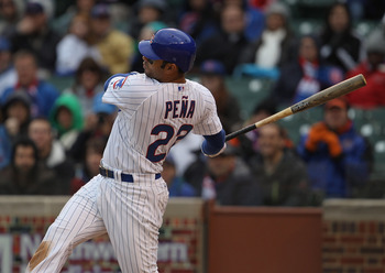 CHICAGO, IL - APRIL 20: Carlos Pena #22 of the Chicago Cubs takes a swing against the San Diego Padres at Wrigley Field on April 20, 2011 in Chicago, Illinois. The Cubs defeated the Padres 2-1 in 11 innings. (Photo by Jonathan Daniel/Getty Images)