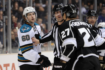 LOS ANGELES, CA - APRIL 19:  Jason Demers #60 of the San Jose Sharks and Alexei Ponikarovsky #27 of the Los Angeles Kings exchange words with each other after being separated by the referee in game three of the Western Conference Quarterfinals during the