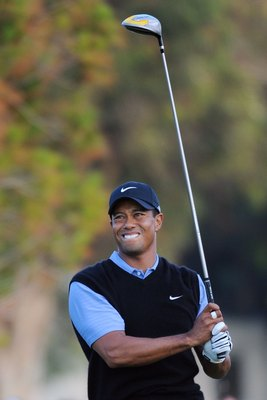 SAN DIEGO - JUNE 14:  Tiger Woods reacts to his shot and winces due to pain from his knee injury during the third round of the 108th U.S. Open at the Torrey Pines Golf Course (South Course) on June 14, 2008 in San Diego, California.  (Photo by Harry How/G