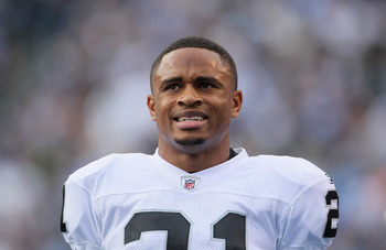 SAN DIEGO - DECEMBER 05:  Nnamdi Asomugha #21 the Oakland Raiders looks on from the sideline against the San Diego Chargers at Qualcomm Stadium on December 5, 2010 in San Diego, California. The Raiders defeated the Chargers 28-13.  (Photo by Jeff Gross/Ge