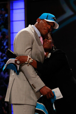 NEW YORK, NY - APRIL 28:  Cam Newton receives a hug from his mother Jackie on stage after he was selected #1 overall by the Carolina Panthers during the 2011 NFL Draft at Radio City Music Hall on April 28, 2011 in New York City.  (Photo by Chris Trotman/G