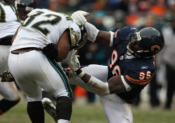 CHICAGO - DECEMBER 07: Alex Brown #96 of the Chicago Bears slows Maurice Jones-Drew #32 of the Jacksonville Jaguars on December 7, 2008 at Soldier Field in Chicago, Illinois. (Photo by Jonathan Daniel/Getty Images)