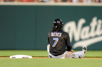 WASHINGTON, DC - APRIL 28:  Jose Reyes #7 of the New York Mets sits in the infield after being thrown out trying to steal second base to end the seventh inning against the Washington Nationals at Nationals Park on April 28, 2011 in Washington, DC. The Nat