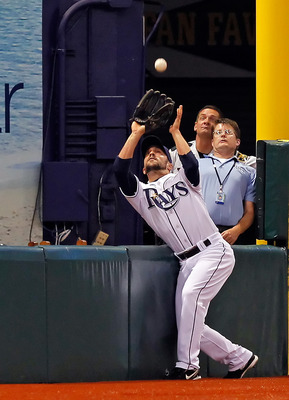 ST. PETERSBURG, FL - APRIL 21:  Outfielder Sam Fuld #5 of the Tampa Bay Rays catches a foul ball against the Chicago White Sox during the game at Tropicana Field on April 21, 2011 in St. Petersburg, Florida.  (Photo by J. Meric/Getty Images)