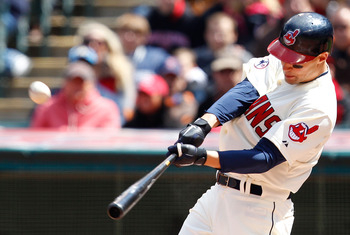 CLEVELAND - APRIL 17:  Grady Sizemore #24 of the Cleveland Indians hits a solo home run against the Baltimore Orioles during the game on April 17, 2011 at Progressive Field in Cleveland, Ohio.  (Photo by Jared Wickerham/Getty Images)