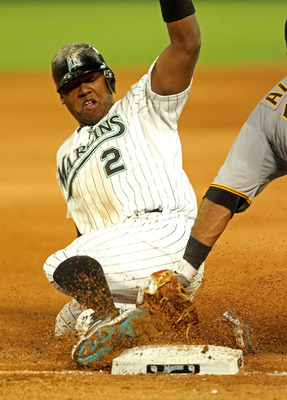 MIAMI GARDENS, FL - APRIL 21:  Hanley Ramirez #2 of the Florida Marlins is tagged out trying to steal third during a game against the Pittsburgh Pirates at Sun Life Stadium on April 21, 2011 in Miami Gardens, Florida.  (Photo by Mike Ehrmann/Getty Images)