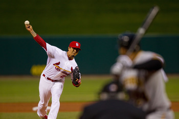 ST. LOUIS, MO - APRIL 4: Starter Kyle Lohse #26 of the St. Louis Cardinals pitches against the Pittsburgh Pirates at Busch Stadium on April 4, 2011 in St. Louis, Missouri.  (Photo by Dilip Vishwanat/Getty Images)