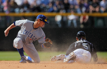 DENVER, CO - APRIL 17:  Carlos Gonzalez #5 of the Colorado Rockies slides in safely as he steals  second base ahead of the tag from second baseman Darwin Barney #15 of the Chicago Cubs at Coors Field on April 17, 2011 in Denver, Colorado.  (Photo by Doug