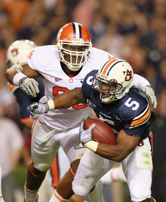 AUBURN, AL - SEPTEMBER 18:  Michael Dyer #5 of the Auburn Tigers against Da'Quan Bowers #93 of the Clemson Tigers at Jordan-Hare Stadium on September 18, 2010 in Auburn, Alabama.  (Photo by Kevin C. Cox/Getty Images)