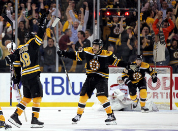 BOSTON, MA - APRIL 27: Nathan Horton #18 of the Boston Bruins celebrates with Milan Lucic #17 after Horton scored the winning goal in overtime against the Montreal Canadiens in Game Seven of the Eastern Conference Quarterfinals during the 2011 NHL Stanley