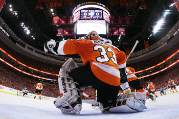 PHILADELPHIA, PA - APRIL 26:  Brian Boucher #33 of the Philadelphia Flyers defends against the Buffalo Sabres in the first period of Game Seven of the Eastern Conference Quarterfinals during the 2011 NHL Stanley Cup Playoffs at Wells Fargo Center on April