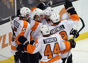 BOSTON, MA - JANUARY 13:  Danny Briere #48 of the Philadelphia Flyers is congratulated by Scott Hartnell #19, Kimmo Timonen #44 and Braydon Coburn #5 after Briere scored in the third period against the Boston Bruins on January 13, 2011 at the TD Garden in