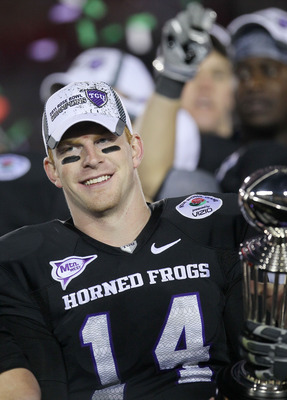PASADENA, CA - JANUARY 01:  Quarterback Andy Dalton #14 of the TCU Horned Frogs celebrates with the Rose Bowl Championship Trophy after defeating the Wisconsin Badgers 21-19 in the 97th Rose Bowl game on January 1, 2011 in Pasadena, California.  (Photo by