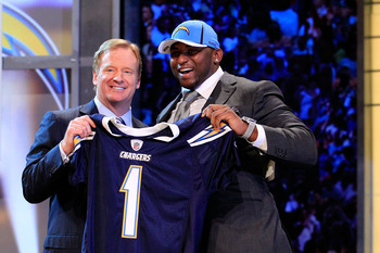 NEW YORK, NY - APRIL 28:  NFL Commissioner Roger Goodell (L) poses for a photo with Corey Liuget, #18 overall pick by the San Diego Chargers, on stage during the 2011 NFL Draft at Radio City Music Hall on April 28, 2011 in New York City.  (Photo by Chris