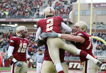 CHESTNUT HILL, MA - OCTOBER 17:  Montell Harris #2  of the Boston College Eagles celebrates his touchdown with teammates Rich Gunnell #18, Anthony Castonzo #74 and  Thomas Claiborne #78 in the second quarter against the North Carolina State Wolf Pack on O