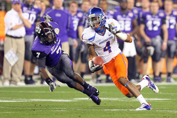 GLENDALE, AZ - JANUARY 04:  Titus Young #4 of the Boise State Broncos runs after a catch past Greg McCoy #7 of the TCU Horned Frogs in the first half during the Tostitos Fiesta Bowl at the Universtity of Phoenix Stadium on January 4, 2010 in Glendale, Ari