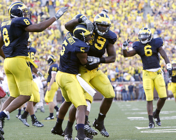 ANN ARBOR, MI - SEPTEMBER 27:  John Thompson #49, Charles Stewart #5, Donovan Warren #6 and Jonas Mouton #8 of the Michigan Wolverines celebrate an interception during the fourth quarter against the Wisconsin Badgers on September 27, 2008 at Michigan Stad