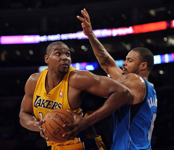 LOS ANGELES, CA - MARCH 31:  Andrew Bynum #17 of the Los Angeles Lakers turns from the defense of Tyson Chandler #6 of the Dallas Mavericks at Staples Center on March 31, 2011 in Los Angeles, California.  NOTE TO USER: User expressly acknowledges and agre